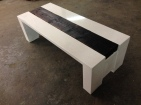White concrete coffee table with a floating shou sugi ban mill timber.